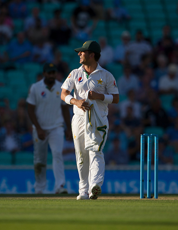 Pakistan's Yasir Shah happy at stumps as he takes 3-15 in Englands 2nd innings<br /> <br /> Photographer Ashley Western/CameraSport<br /> <br /> International Cricket - 4th Investec Test - England v Pakistan - Day 3 - Saturday 13th August 2016 - The Oval - London<br /> <br /> World Copyright &copy; 2016 CameraSport. All rights reserved. 43 Linden Ave. Countesthorpe. Leicester. England. LE8 5PG - Tel: +44 (0) 116 277 4147 - admin@camerasport.com - www.camerasport.com