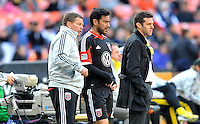 Carlos Ruiz (20) of D.C. United is given the last instructions from assistant coach Chad Ashton before entering the game. The Columbus Crew defeated D.C. United 2-1 ,at RFK Stadium, Saturday March 23,2013.
