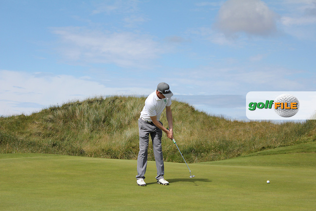 Stuart Grehan (Tullamore) on the 15th green during Matchplay Round 3 of the South of Ireland Amateur Open Championship at LaHinch Golf Club on Saturday 25th July 2015.<br /> Picture:  Golffile | TJ Caffrey