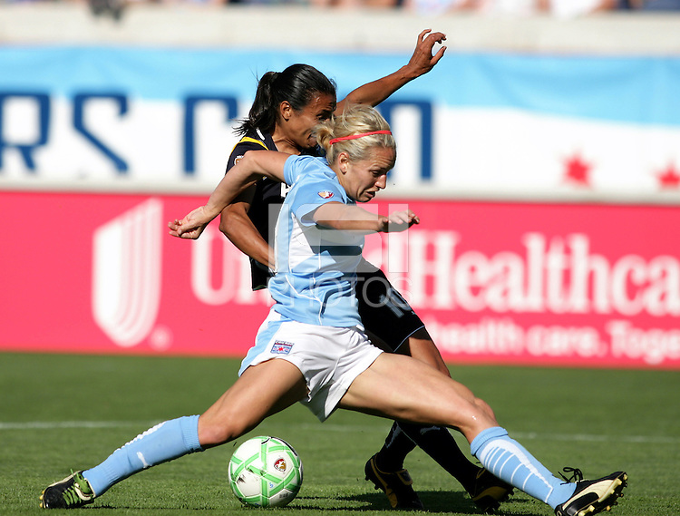 Chicago Red Stars defender Natalie Spilger (13) attempts to block a shot by LA Sol midfielder Marta (10).  The Chicago Red Stars defeated the LA Sol 3-1 at Toyota Park in Bridgeview, IL on August 2, 2009.