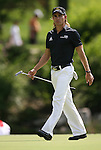 6 September 2008:   Camilo Villegas walks on the green of the third hole in the second round of play at the BMW Golf Championship at Bellerive Country Club in Town & Country, Missouri, a suburb of St. Louis, Missouri.  The BMW Championship is the third event on the PGA's Fed Ex Tour. Villegas, of Medellin Colombia (South America) was the leader after the conclusion of round one with a five-under par score.