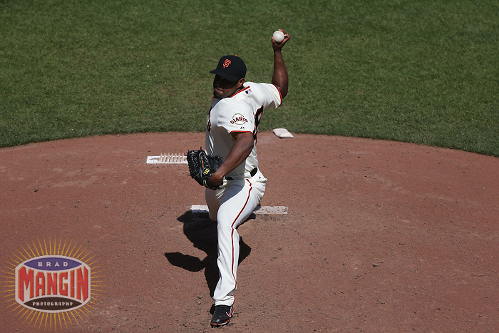 SAN FRANCISCO - MAY 17:  Santiago Casilla of the San Francisco Giants pitches during the game against the St. Louis Cardinals at AT&T Park on May 17, 2012 in San Francisco, California. (Photo by Brad Mangin)