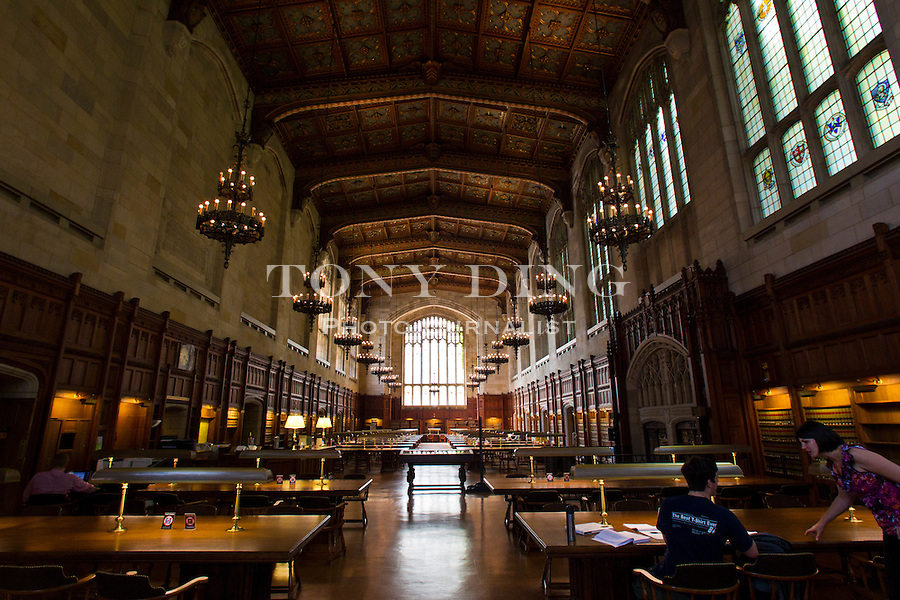 The vaulted ceiling and long rows of wooden reading tables silence all who step inside the University of Michigan Law School library, Friday, Sept. 2, 2011 in Ann Arbor, Mich. (Tony Ding for The New York Times)