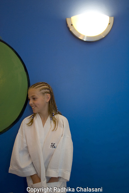 SAN ANTONIO, TEXAS-MARCH 25: Madison (10) hangs out in the blue room at the kids-only spa, Spaaht, at the Hyatt Hill Country Resort March 25, 2005 in San Antonio.  The spa is one of a growing number across the U.S. catering to the teen and pre-teen age group and offering massages (40 USD), facials (40 USD), glitter manicures (30 USD), pedicures (35 USD) and hair braiding (3.50 USD/braid).(Photo by Radhika Chalasani/Getty Images)