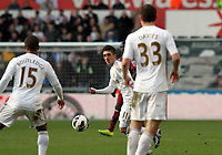 Pictured: Swansea's Pablo Hernandez passes the ball to Wayne Routledge<br />
