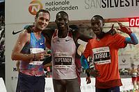 Eric Kiptanui winner (c), Amos Kirui, 2nd (r) and Toni Abadia, 3rd, celebrate after the San Silvestre Vallecana 2017. December 31,2017. (ALTERPHOTOS/Acero) /NortePhoto.com