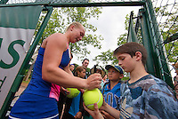 Paris, France, 28 June, 2016, Tennis, Roland Garros, Kiki Bertens (NED) defeated Daria Kasatkina (RUS) and signs autographs<br /> Photo: Henk Koster/tennisimages.com
