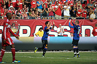 Manchester United defender Rafael da Silva (21) gets high fives from teammate Wayne Rooney (10) after scoring Manchester United's second goal.  Manchester United defeated the Chicago Fire 3-1 at Soldier Field in Chicago, IL on July 23, 2011.