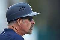 Queens Royals head coach Jack McDowell looks on from the dugout during the game against the Mars Hill Lions at Intimidators Stadium on March 30, 2019 in Kannapolis, North Carolina. The Royals defeated the Bulldogs 11-6 in game one of a double-header. (Brian Westerholt/Four Seam Images)