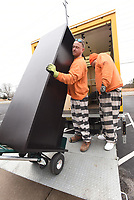 NWA Democrat-Gazette/FLIP PUTTHOFF<br />Mark Sharp (left) and Miguel SIngleterry, inmates at the Benton County Jail, load office furniture Tuesday Jan. 2 2018 during the Benton County Election Commission's move from Bentonville to Rogers. The new location is in the former Kmart buiding at 2113 W. Walnut St. in Rogers.
