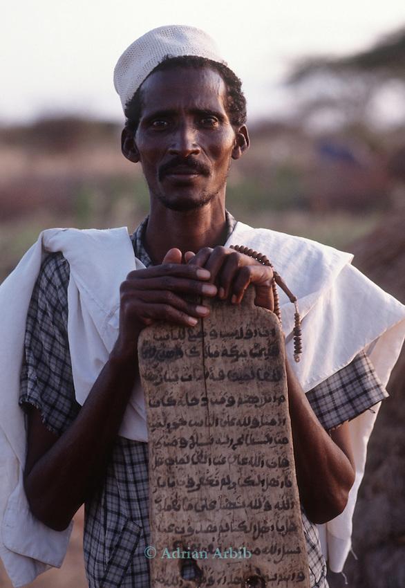 Somali man and prayer board , Wajir, Somaliland, Kenya