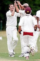 I Gregory (L) of Hornsey is congratulated after dismissing a North London player during the Middlesex County League Division Three game between Hornsey and North London at Tivoli Road, Crouch End on Sat July 17, 2010