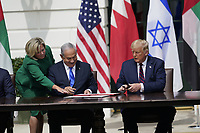 "Prime Minister Benjamin Netanyhu of Israel and United States President Donald J. Trump sign the ""Abraham Accords"" on the South Lawn of the White House in Washington, DC on Tuesday, September 15, 2020. <br /> Credit: Chris Kleponis / Pool via CNP /MediaPunch"