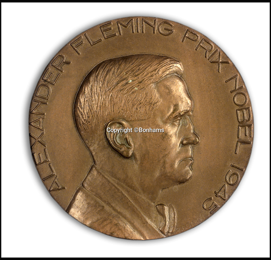 BNPS.co.uk (01202 558833)<br /> Pic: Bonhams/BNPS<br /> <br /> Also in the sale, the Nobel prize bronze medal.<br /> <br /> Two samples of mould that Sir Alexander Fleming used to produce penicillin have emerged for sale as part of a remarkable £15,000 archive relating to the legendary scientist.<br /> <br /> Both specimens of the yellow-green Penicillium Notatum fungus are contained on a glass disc and date back to the 1930s when Fleming was developing his 1928 discovery of penicillin. <br /> <br /> The treatment has gone on the save millions of lives across the world.<br /> <br /> Indeed, as part of the archive that has emerged at Bonhams is a poignant letter of thanks from a father to the biologist for helping to save his daughter's life.
