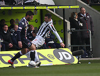 Steven Thompson tackles Evangelos Ikonomou in the St Mirren v Ross County Clydesdale Bank Scottish Premier League match played at St Mirren Park, Paisley on 19.1.13.