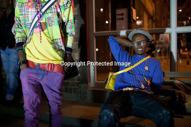 JOHANNESBURG, SOUTH AFRICA - Young designers wait outside a fashion show at the annual Sanlam fashion week at Turbine Hall in central Johannesburg, South Africa. The countries top designers showed their new clothes. (Photo by: Per-Anders Pettersson).