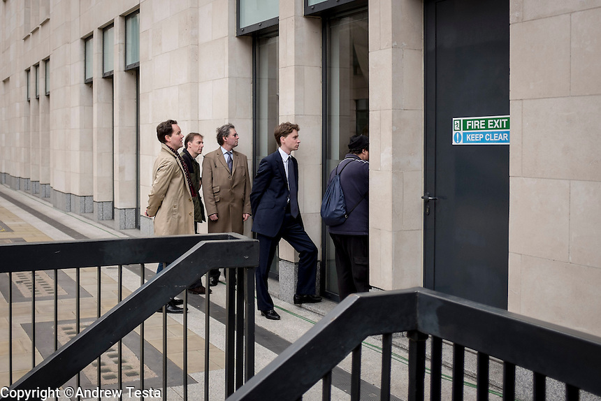 UK. London. 17th April 2013..Mourners look through windows to watch Margaret Thatcher's funeral on television..©Andrew Testa/Panos