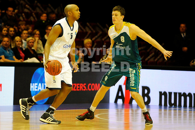 GRONINGEN - Basketbal, Martiniplaza,  Gasterra Flames - Landstede,  Dutsch Basketball League,  play-offs, seizoen 2011-2012, 01-05-2012 sergio de randamie (l) met Nikki Hulzebos (r)..