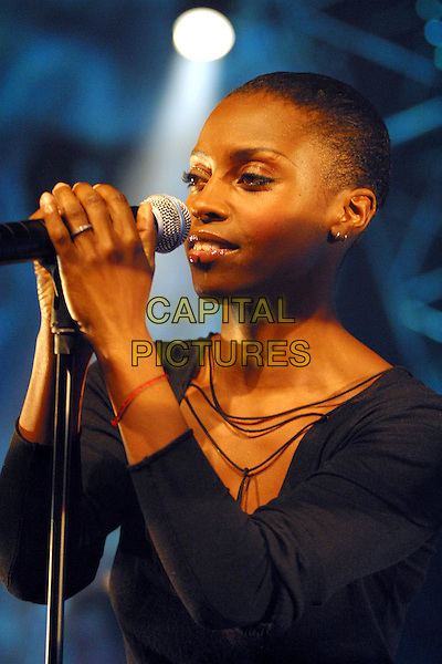 MORCHEEBA - SKYE.Live at the CCH3 in Hamburg. .17 November 2002.singing, microphone, live, stage, concert, music, headshot, portrait.www.capitalpictures.com.sales@capitalpictures.com.©Capital Pictures.