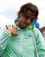 Rafael Nadal (ESP) against Feliciano Lopez (ESP) in the quarter final of the men's singles. Feliciano Lopez beat Rafael Nadal 7-6 6-4..Tennis - ATP World Tour - AEGON Championships - Queen's Club - London - Day 5 - Fri 11 Jun 2010..© AMN Images - Level 1, Barry House, 20-22 Worple Road, London, SW19 4DH.Tel - +44 (0) 208 947 0100.email - mfrey@advantagemedianet.com. www.photoshelter.com/c/amnimages.