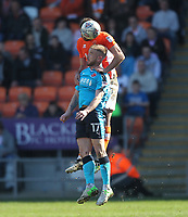 Blackpool's Clark Robertson jumps with  Fleetwood Town's Paddy Madden<br /> <br /> Photographer Mick Walker/CameraSport<br /> <br /> The EFL Sky Bet League One - Blackpool v Fleetwood Town - Saturday 14th April 2018 - Bloomfield Road - Blackpool<br /> <br /> World Copyright &copy; 2018 CameraSport. All rights reserved. 43 Linden Ave. Countesthorpe. Leicester. England. LE8 5PG - Tel: +44 (0) 116 277 4147 - admin@camerasport.com - www.camerasport.com