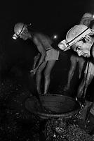 Miners working inside an underground mine at North Searsole Coliery in Ranigunj, West Bengal, India. Arindam Mukherjee