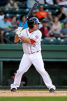 Infielder Tim Roberson (15) of the Greenville Drive bats in a game against the Kannapolis Intimidators on Friday, April 11, 2014, at Fluor Field at the West End in Greenville, South Carolina. Greenville won, 13-2. (Tom Priddy/Four Seam Images)
