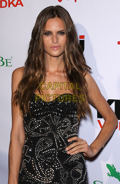 Izabel Goulart.The 2012 Sports Illustrated Swimsuit Models celebrate at the SI Swimsuit On Location Event at Haze Nightclub at Aria Resort and Casino, Las Vegas, Nevada, USA..February 15th, 2012.half length black strapless dress beads beaded hand on hip.CAP/ADM/MJT.© MJT/AdMedia/Capital Pictures.