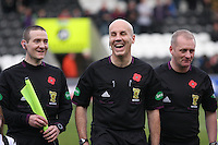 Referee Stephen Finnie having a laugh flanked by his assistants Stewart MacMillan (left) and Tom Murphy in the St Mirren v Aberdeen Clydesdale Bank Scottish Premier League match played at St Mirren Park, Paisley on 9.11.12.