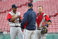 Gwinnett Braves starting pitcher Julio Teheran #27  listens to pitching coach Marty Reed #22 as catcher J.C. Boscan #7 listens in during a game against the Buffalo Bisons at Coca-Cola Field on May 17, 2012 in Buffalo, New York.  Buffalo defeated Gwinnett 4-2.  (Mike Janes/Four Seam Images)