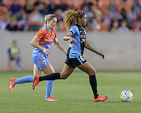 Casey Short (6) of the Chicago Red Stars dribbles the ball towards the Houston goal with Kealia Ohai (7) of the Houston Dash in pursuit in the first half on Saturday, April 16, 2016 at BBVA Compass Stadium in Houston Texas.
