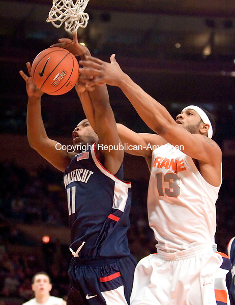 NEW YORK, NY--07 MARCH 2007--030707JS02-UConn's Jerome Dyson battles Syracuse's Darryl Watkins for a rebound during their Big East tournament game Wednesday at Madison Square Garden in New York City. UConn lost 78-65.<br /> <br /> Jim Shannon / Republican-American