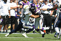 09/11/11 San Diego, CA: San Diego Chargers defensive back Eric Weddle #32 and Minnesota Vikings wide receiver Percy Harvin #12 during an NFL game played at Qualcomm Stadium between the San Diego Chargers and the Minnesota Vikings. The Chargers defeated the Vikings 24-17.