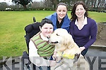 Christian Mayse who suffers from muscular dystrophy with his dog Adam  which he got from dogs for disabled to help Christian in everyday tasks also in photo are his mother Martina and Jenifer Dowler Dog Trainer on Right.