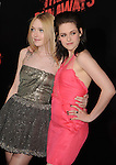 HOLLYWOOD, CA. - March 11: Actresses Dakota Fanning and Kristen Stewart arrive at the Los Angeles Premiere of The Runaways at ArcLight Cinemas Cinerama Dome on March 11, 2010 in Hollywood, California.