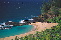 People relaxing at and exploring Lumaha'i Beach on the north shore of Kaua'i.