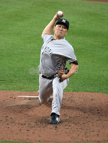 New York Yankees starting pitcher Masahiro Tanaka (19) works in the fourth inning against the Baltimore Orioles at Oriole Park at Camden Yards in Baltimore, MD on Tuesday, July 10, 2018.<br /> Credit: Ron Sachs / CNP<br /> (RESTRICTION: NO New York or New Jersey Newspapers or newspapers within a 75 mile radius of New York City) Credit: Ron Sachs/MediaPunch
