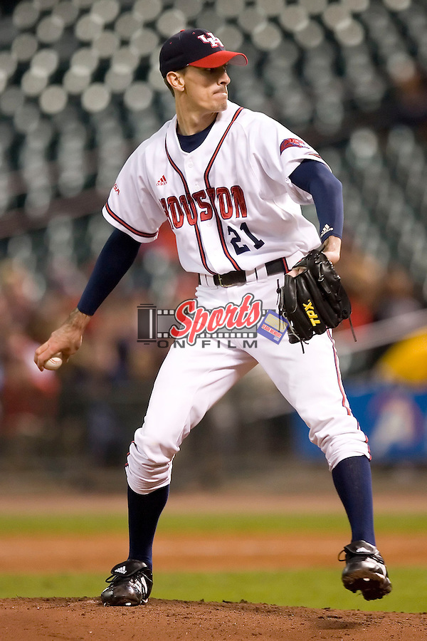 Houston's Aaron Brown (21) winds up to deliver a pitch versus Baylor at the 2007 Houston College Classic at Minute Maid Park in Houston, TX, Friday, February 9, 2007.  Houston defeated Baylor 4-2.