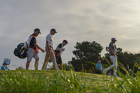 Matt Kuchar (USA) and Tony Finau (USA) head down 11 during day 1 of the Valero Texas Open, at the TPC San Antonio Oaks Course, San Antonio, Texas, USA. 1/5/2014.<br /> Picture: Golffile | Ken Murray<br /> <br /> <br /> All photo usage must carry mandatory copyright credit (© Golffile | Ken Murray)