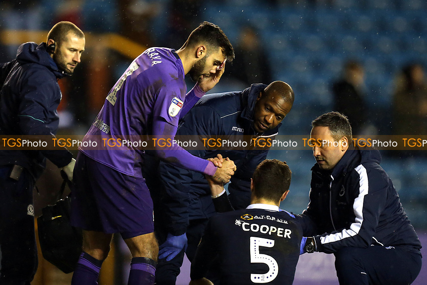 A bloodied David Raya of Blackburn Rovers and Jake Cooper of Millwall shake hands  during Millwall vs Blackburn Rovers, Sky Bet EFL Championship Football at The Den on 12th January 2019