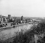 View of Pittsburgh along the Monongahela River - 1962. Buildings William Penn Place, Grant and Gulf Buildings along with Fort Pitt Boulevard
