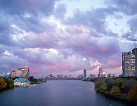 sunset clouds Charles River, Boston skyline, MA from BU bridge with DeWolfe boathouse