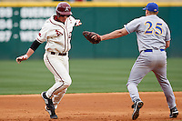 Jesse Sawyer (25) tags out James McCann (27);March 10th, 2010; South Dakata State University vs Arkansas Razorbacks at Baum Stadium in Fayetteville Arkansas. Photo by: William Purnell/Four Seam Images
