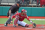 P.J. Jones digs a pitch out of the turf during the Pac-12 Conference tilt between the Washington State Cougars and Oregon State Beavers at Bailey-Brayton Field in Pullman, Washington, on April 12, 2014.