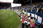 A group of display dancers wait nervously in front of the Kop stand before Sheffield Wednesday take on Peterborough United in a Coca-Cola Championship match at Hillsborough Stadium, Sheffield. The home side won by 2 goals to 1 giving Alan Irvine his third straight win since taking over as Wednesday's manager.