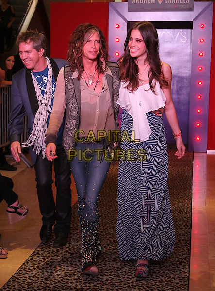 Andy Hilfiger, Steven Tyler and Chelsea Tyler.Steven Tyler & Andy Hilfiger host Andrew Charles' Fashion Show,  Macy's, Sherman Oaks, California, USA..April 7th, 2012.full length jeans denim beige shirt waistcoat grey gray father dad daughter family dress.CAP/ADM/KB.©Kevan Brooks/AdMedia/Capital Pictures.