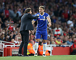 Chelsea's Branislav Ivanovic speaks to Antonio Conte during the Premier League match at the Emirates Stadium, London. Picture date September 24th, 2016 Pic David Klein/Sportimage