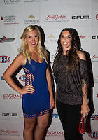 Aug. 29, 2013; Avon, IN, USA: NHRA NHRA funny car drivers Courtney Force (left) and Alexis DeJoria on the red carpet at the premiere of Snake & Mongoo$e at the Regal Shiloh Crossing Stadium 18. Mandatory Credit: Mark J. Rebilas-