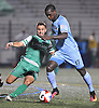 Jimmy Mulligan #28 of the New York Cosmos, left, sweeps a ball away from Lance Laing #17 of the Minnesota United in the second half of a NASL match at Hofstra University on Saturday, Sept. 10, 2016. The Cosmos won by a score of 1-0.