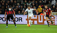 Neil Taylor of Swansea (C) takes in Andrew Surman (L) and Dan Gosling of Bournemouth (R) during the Barclays Premier League match between Swansea City and Bournemouth at the Liberty Stadium, Swansea on November 21 2015